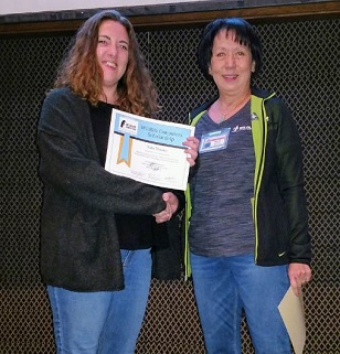 Katie Downs Accepting Scholarship from Wildlife Computers